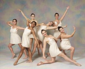 A group of dancers pose in lyrical costumes