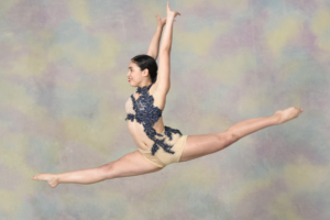 A dancer leaping in the air