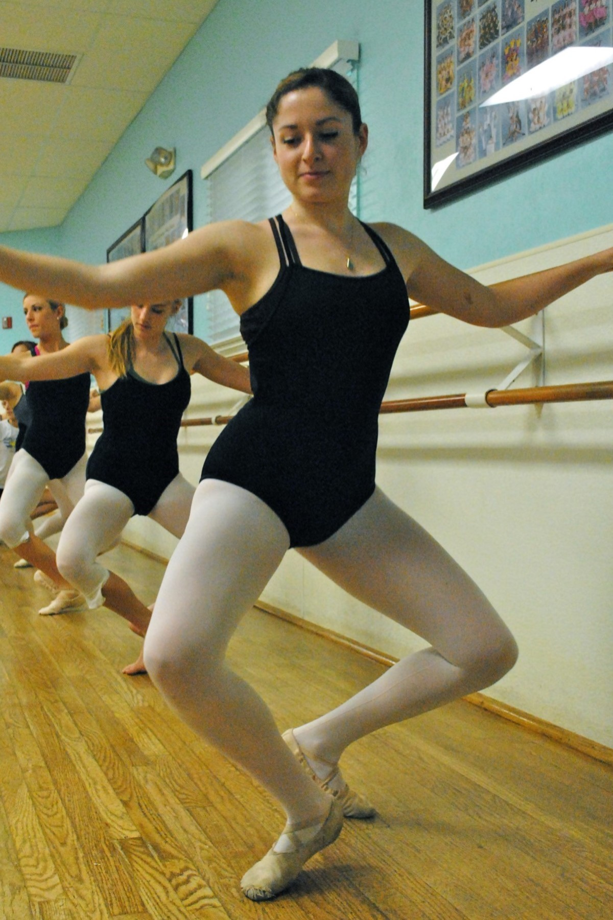 A dancer doing a plie at the barre