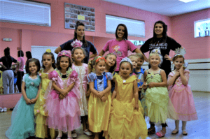 Young dancers in princess costumes pose with three teachers