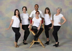 A group of adult dancers wearing tap shoes