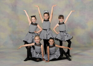 A small group of young dancers wearing jazz shoes