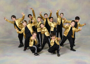 A group of boy dancers doing a hip hop pose